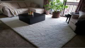 how to stop rugs creeping up on carpet
