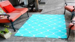 how to keep outdoor rugs in place on concrete