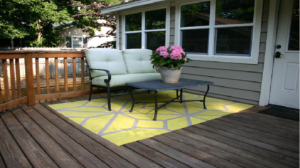 will an outdoor rug damage a wood deck